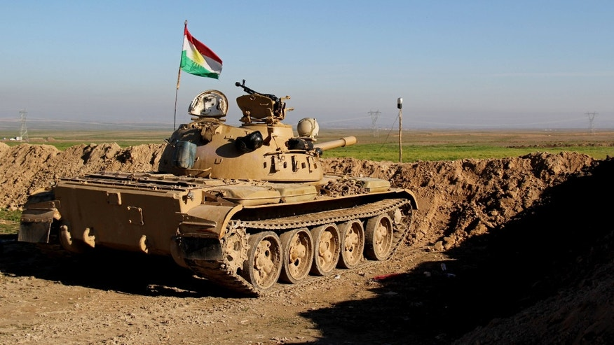 Jan. 20, 2015: Kurdish peshmerga forces prepare on the front line for battle against Islamic State group positions.