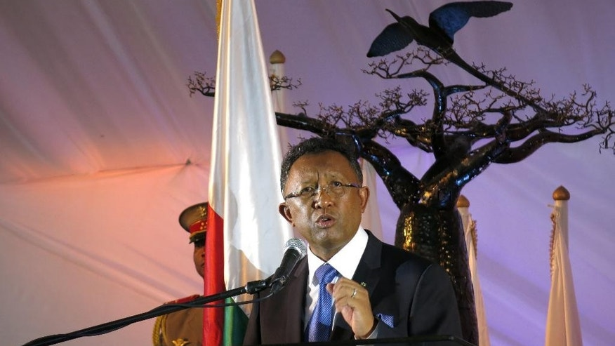 In this photo taken Friday Jan. 9, 2015, Madagascan president Hery Rajaonarimampianina speaks at a new year address in Antananarivo, Madagascar. Rajaonarimampianina is on the defensive after just a year in office over complaints of bad roads that are gridlocked and cuts in electricity supplies. (AP Photo/Martin Vogl)