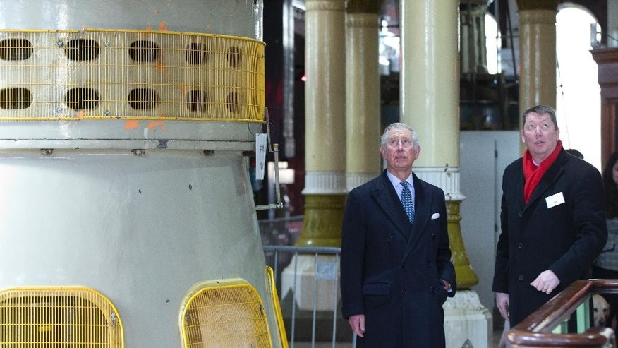 Britain's Prince Charles, left with Martin Baggs the CEO of Thames Water look at the interior during a visit to the Abbey Mills Pumping station London, Wednesday, Feb. 18, 2015. The Abbey Mills pumping station is one of the crown jewels of the Victorian sewage system that Joseph Bazalgette designed to help relive the chronic water and sewage problems London's growing population in 1865, and Prince Charles's visit is to commemorate the 150th anniversary of the start of the modern water system that serves London.(AP Photo/Alastair Grant, Pool)