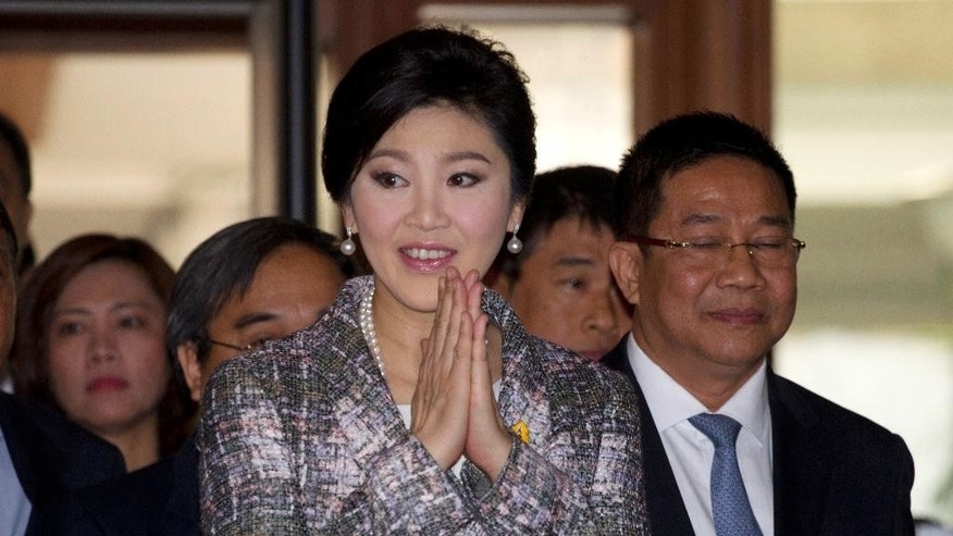 In this Thursday, Jan. 22, 2015 photo,  Thailand's former Prime Minister Yingluck Shinawatra arrives at parliament in Bangkok, Thailand. Thailand's attorney general on Thursday, Feb. 19, 2015,  pressed criminal charges against former Prime Minister Yingluck for negligence related to her government's money-losing rice subsidy scheme, a move likely to prolong conflicts in a divided nation plagued by political turmoil and coups.(AP Photo/Sakchai Lalit)