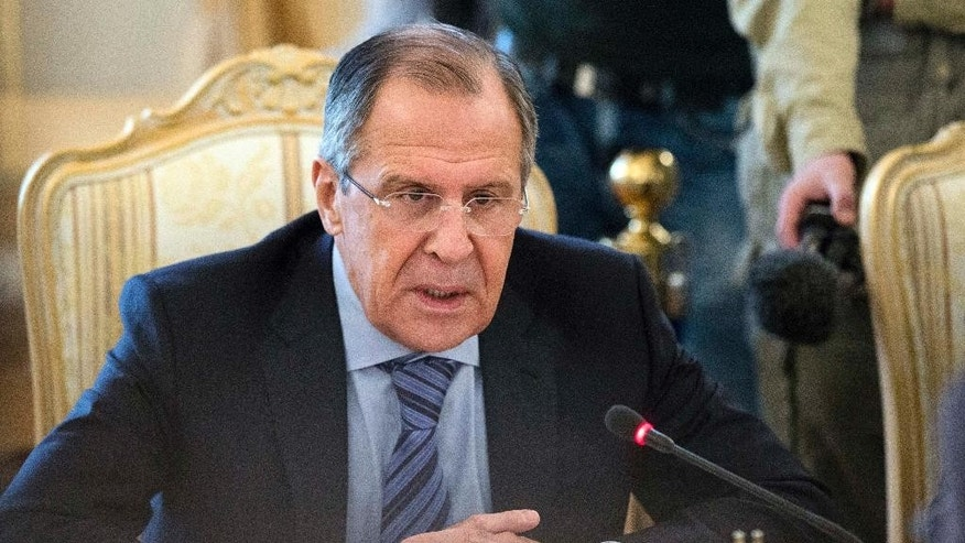 Russian Foreign Minister Sergey Lavrov speaks during a meeting with his counterpart from Georgia's breakaway province of South Ossetia David Sanakoyev in Moscow, Russia, Wednesday, Feb. 18, 2015.  On Wednesday Lavrov indicated that any solution in Ukraine must protect the rights of all Ukrainian citizens. (AP Photo/Pavel Golovkin)