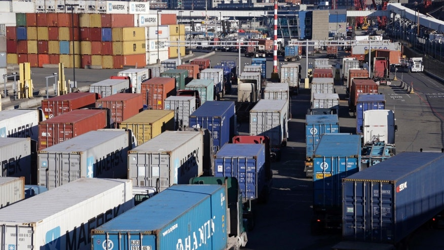 Loaded container trucks line-up at a gate at the Port of Seattle, Tuesday, Feb. 17, 2015, in Seattle. Seaports in the U.S. West Coast that were all but shut over the weekend because of a contract dispute are reopening as the nation's top labor official tries to solve a stalemate between dockworkers and their employers that already has disrupted billions of dollars in U.S. international trade. U.S. Labor Secretary Thomas Perez plans to meet Tuesday in San Francisco with negotiators for both the dockworkers' union and the maritime association, which represents shipping lines that carry cargo and port terminal operators that handle it once the ships dock. (AP Photo/Elaine Thompson)