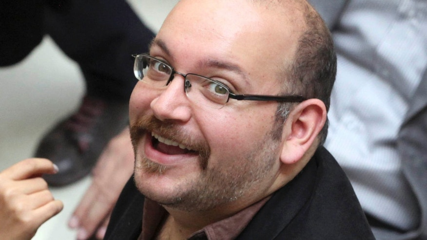 April 11, 2013:  Jason Rezaian, an Iranian-American correspondent for the Washington Post, smiles as he attends a presidential campaign of President Hassan Rouhani in Tehran, Iran.