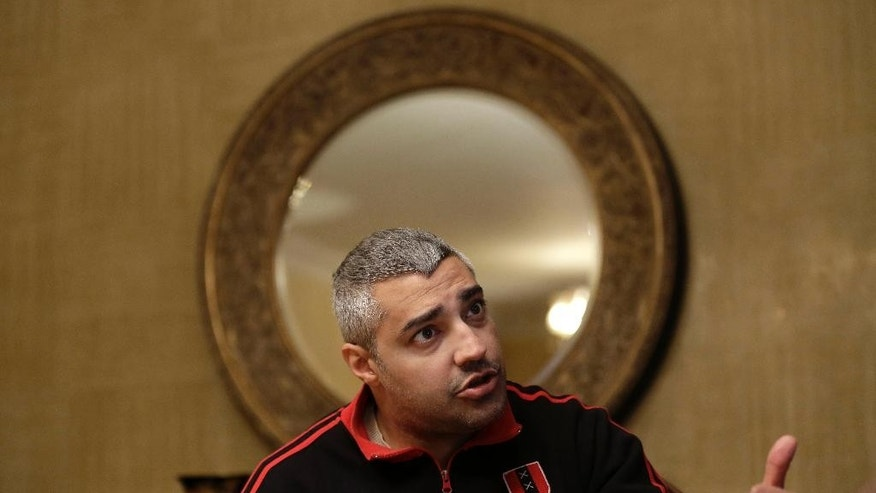 Canadian Al-Jazeera English journalist Mohamed Fahmy, speaks during an interview with The Associated Press in Cairo, Egypt, Thursday, Feb. 19, 2015. Al-Jazeera journalists Fahmy and Baher Mohammed are free pending their retrial, scheduled for Feb. 23. A third colleague, Peter Greste, was released two weeks ago and deported to his home country of Australia. (AP Photo/Hassan Ammar)