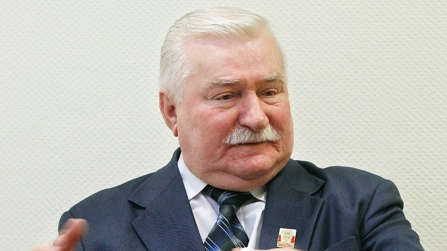 Poland's former president and Solidarity leader Lech Walesa talks with The Associated Press in Warsaw, Poland, Thursday, Feb. 19, 2015 about the need for global solidarity in using economic sanctions against Russian President Vladimir Putin as a means of obtaining a change in his aggressive policy. (AP Photo/Czarek Sokolowski)