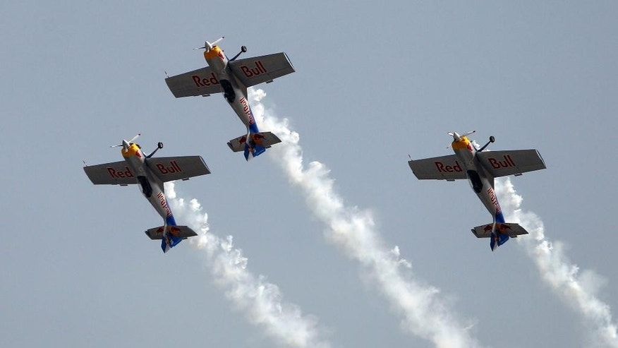 Feb. 19, 2015: Red Bull's single-engine and single-seater aircrafts fly in a formation as they perform on the second day of Aero India 2015 at Yelahanka air base in Bangalore, India. (AP)
