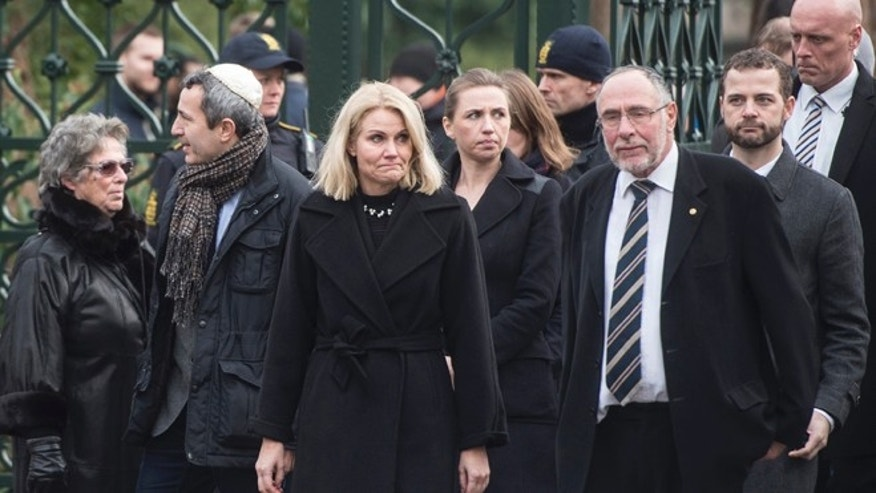 Feb. 18, 2015: Chairman of the Jewish Society, Dan Rosenberg Asmussen, second left, Prime Minister Helle Thorning-Schmidt,, Chief Rabbi Bent Lexner, right, after the funeral of Dan Uzan who was killed in one of Sunda's attacks in Copenhagen. (AP)