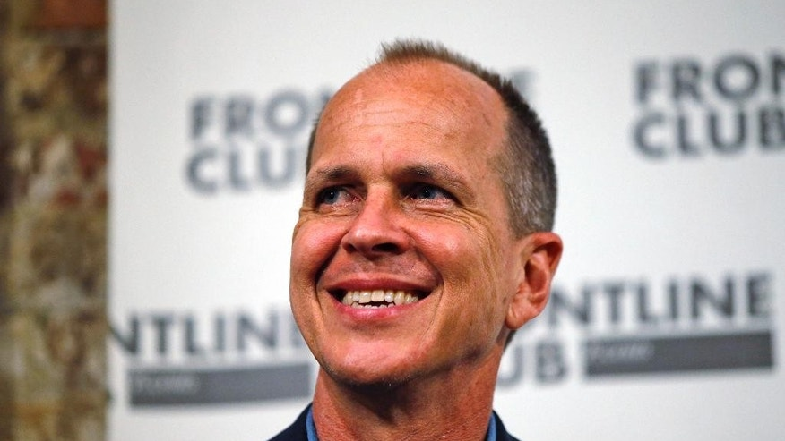 Freed Al Jazeera journalist Peter Greste smiles as he answers a question during an event in central London, Thursday, Feb. 19, 2015. Greste discussed his detention in Egypt and the case against him and colleagues Baher Mohammed and Mohamed Fahmy. Greste was released after spending over 400 days in jail following his conviction in July 2014 for spreading false news and supporting the Muslim Brotherhood. His colleagues were released on bail on Feb. 12, 2015. (AP Photo/Lefteris Pitarakis)