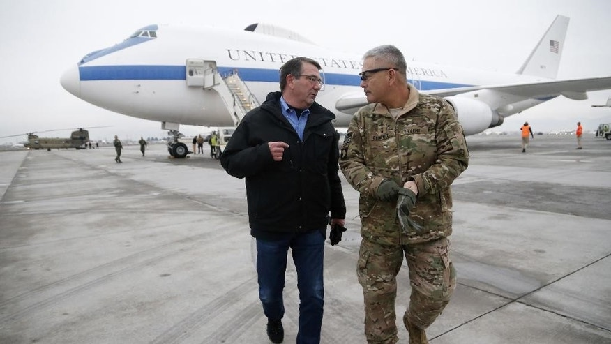 U.S. Secretary of Defense Ashton Carter, left, walks with U.S. Army Gen. John Campbell upon arrival at Hamid Karzai International Airport in Kabul, Afghanistan, Saturday, Feb. 21, 2015. Carter made his international debut Saturday with a visit to Afghanistan to see American troops and commanders, meet with Afghan leaders and assess whether U.S. withdrawal plans are too risky to Afghan security. (AP Photo/Jonathan Ernst, Pool)