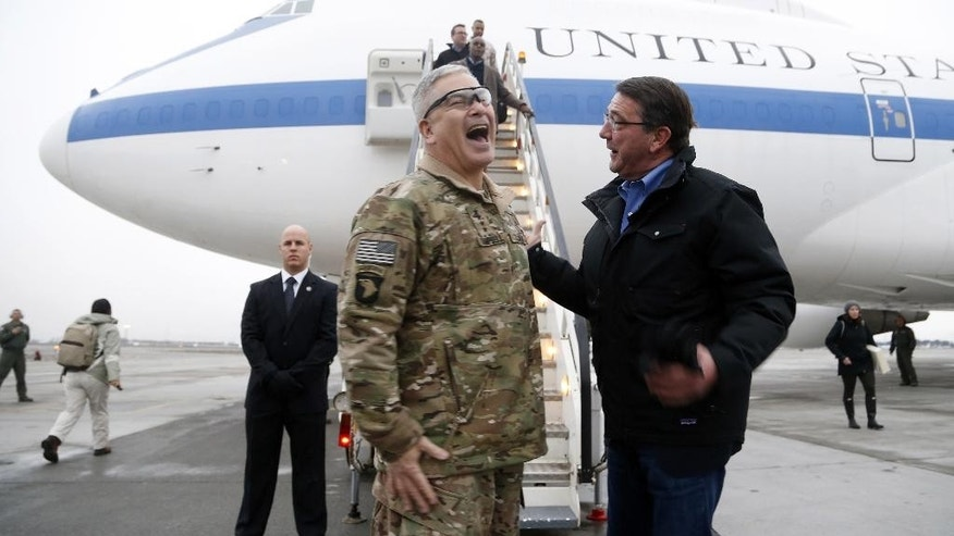 U.S. Secretary of Defense Ashton Carter, right, elicits laugh from U.S. Army Gen. John Campbell, who greeted him upon arrival at Hamid Karzai International Airport in Kabul, Afghanistan, Saturday, Feb. 21, 2015. Carter made his international debut Saturday with a visit to Afghanistan to see American troops and commanders, meet with Afghan leaders and assess whether U.S. withdrawal plans are too risky to Afghan security. (AP Photo/Jonathan Ernst, Pool)