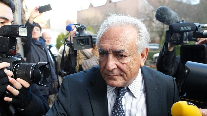 Former International Monetary Fund head Dominique Strauss-Kahn arrives at his hotel in Lille, northern France, Tuesday, Feb. 17, 2015. A French prosecutor has called for the acquittal of Dominique Strauss-Kahn in his pimping trial in Lille — a day after five of six plaintiffs dropped their accusations. (AP Photo/Michel Spingler)