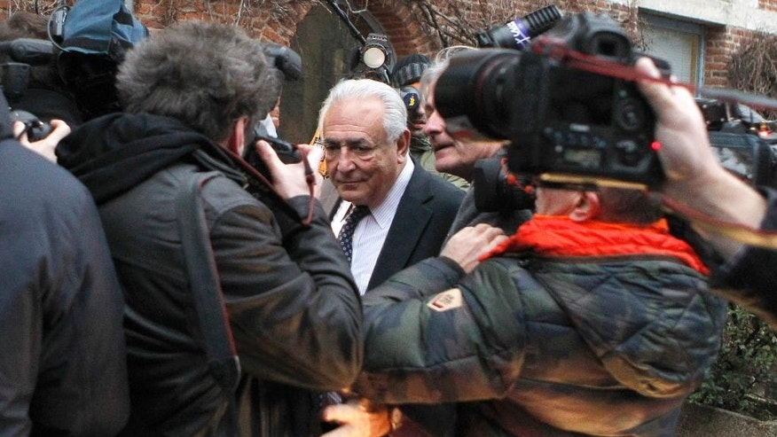 "Former International Monetary Fund chief Dominique Strauss-Kahn is surrounded by photographers as he leaves his hotel for a court for trial for sex charges, in Lille, northern France, Tuesday, Feb. 17, 2015. A French prosecutor has pushed for the acquittal of Dominique Strauss-Kahn in his pimping trial in Lille _ a day after five of six plaintiffs dropped their accusations against him. Frederic Fevre said the former International Monetary Fund chief should be acquitted ""pure and simple"" _ saying that ""his notoriety shouldn't be in any way a presumption of guilt."" (AP Photo/Michel Spingler)"