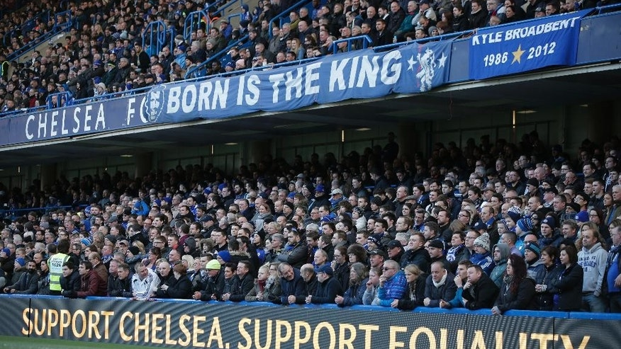 """Chelsea fans watch an English Premier League soccer match against Burnley at the Stamford Bridge ground in London, Saturday, Feb. 21, 2015. British police launched an investigation into further suspected racism involving Chelsea fans as the London club used Saturday's Premier League game to celebrate diversity in football. Stickers emblazoned with """"Support Chelsea Support Equality"""" were handed out at Stamford Bridge after a week when public acts of racism by some Chelsea fans brought a renewed focus on football's fight against discrimination. (AP Photo/Lefteris Pitarakis)"""
