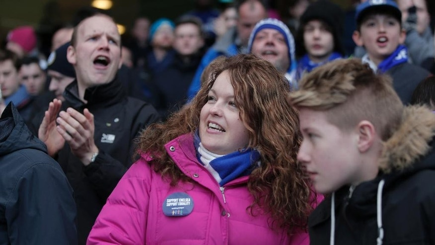 """A Chelsea fan wears an anti-racism sticker as he watches an English Premier League soccer match against Burnley at the Stamford Bridge ground in London, Saturday, Feb. 21, 2015. British police launched an investigation into further suspected racism involving Chelsea fans as the London club used Saturday's Premier League game to celebrate diversity in football. Stickers emblazoned with """"Support Chelsea Support Equality"""" were handed out at Stamford Bridge after a week when public acts of racism by some Chelsea fans brought a renewed focus on football's fight against discrimination. (AP Photo/Lefteris Pitarakis)"""