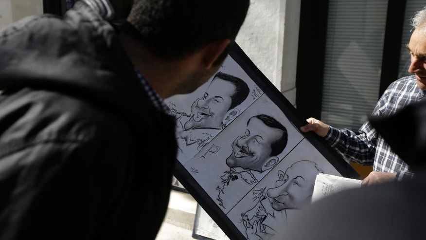 A street artist shows to Turkish tourists his fun caricature portraits of Greek Prime Minister Alexis Tsipras, left, his Turkish counterpart Recep Tayyip Erdogan, center, and Russian President Vladimir Putin in the traditional Plaka district of Athens on Saturday, Feb. 21, 2015.  Greece's government starts working on drafting a series of economic reforms it must present to the other euro zone finance ministers on Monday, as part of an agreement reached Friday to extend the country's European loan agreement. (AP Photo/Thanassis Stavrakis)