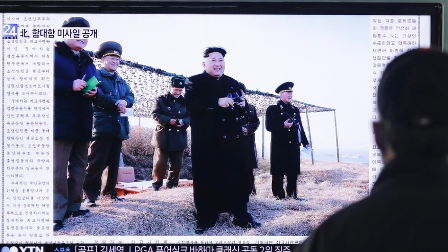 Feb. 8, 2015: A man watches a TV news program showing that North Korea's Rodong Sinmun newspaper front-pages a photo of North Korean leader Kim Jong Un.