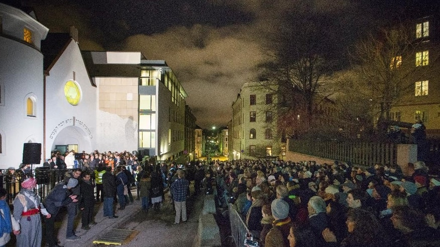 "More than 1,000 people formed a ""ring of peace"" around the Norwegian capital's synagogue, an initiative taken by young Muslims in Norway after a series of attacks against Jews in Europe, in Oslo, Saturday, Feb. 21 2015. Norway's Chief Rabbi Michael Melchior sang the traditional Jewish end of Shabaat song outside the Oslo synagogue before a large crowd holding hands.  (AP Photo / Hakon Mosvold Larsen / NTB Scanpix) NORWAY OUT"