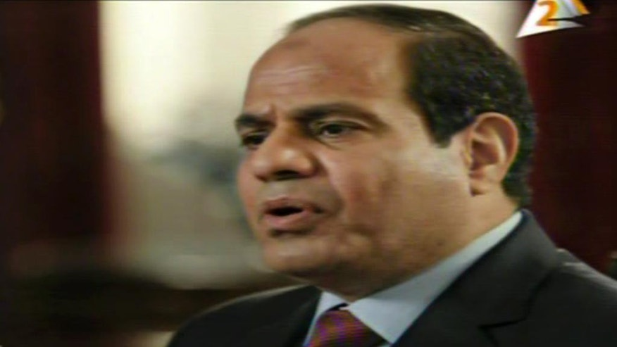 In this image taken from Egypt State TV, Egyptian President Abdel-Fattah el-Sissi speaks in a television address broadcast Sunday, Feb. 22, 2015. Sissi said the need for a joint Arab military force is growing every day as the region is faced with the threat of Islamic militancy. The Egyptian leader said both Jordan and the United Arab Emirates have offered to dispatch troops to aid Egypt following last week's beheading in Libya of 21 Egyptian Coptic Christians by Islamic State militants. Logo on right is for Egypt TV Channel 2.  (AP Photo/Egypt State TV)