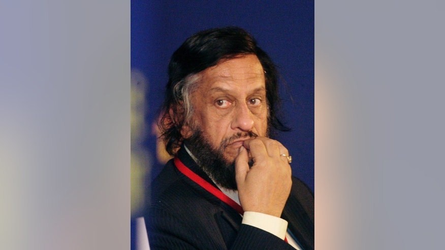 FILE- In this Feb. 6, 2010 file photo,Intergovernmental Panel on Climate Change Chairman Rajendra Pachauri listens to a speaker at the Delhi Sustainable Development Summit in New Delhi, India. The Indian leader of the U.N.'s expert panel on climate change has pulled out of a key meeting in Nairobi while pledging to cooperate with New Delhi police investigating allegations of sexual harassment . (AP Photo/Gurinder Osan, file)