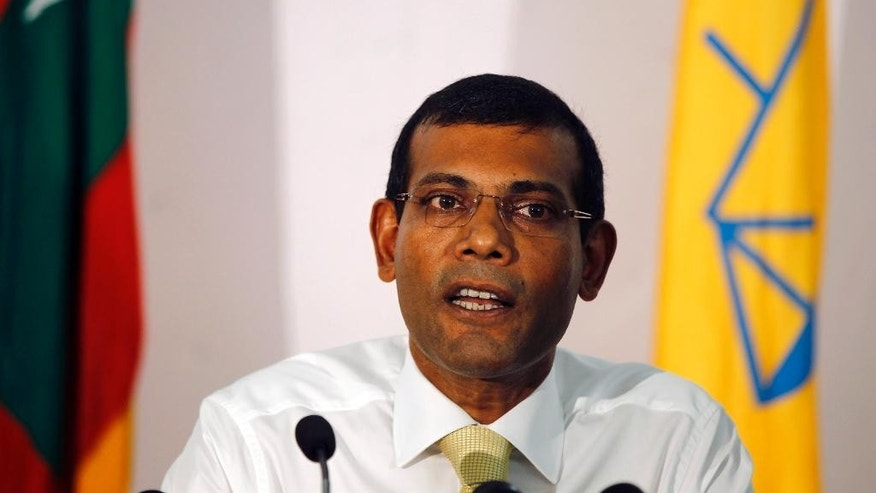 FILE- In this Nov. 10, 2013 file photo, former Maldives President and the then presidential candidate, Mohamed Nasheed, speaks to the media in Male, Maldives.  Maldives authorities arrested former President and current opposition leader Nasheed Sunday, Feb. 22, 2015, ordering him to stand trial for his 2012 decision to arrest a senior judge.(AP Photo/Sinan Hussain, File)