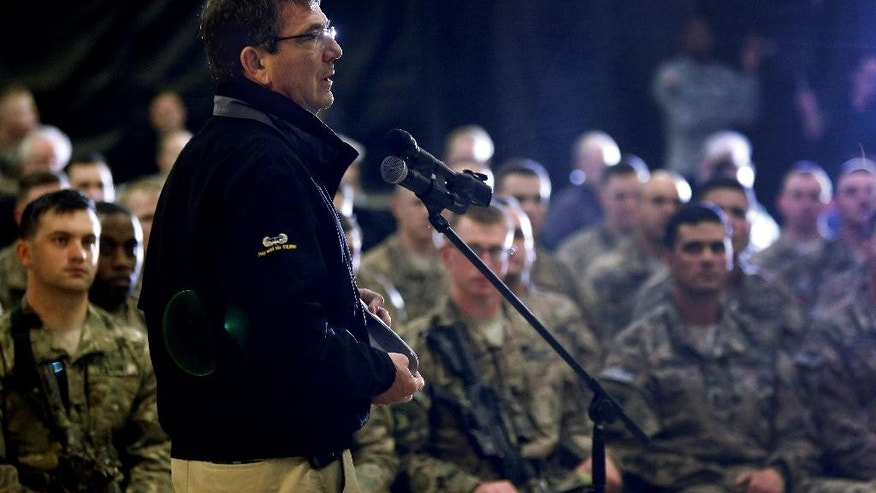 U.S. Defense Secretary Ash Carter speaks with U.S. military personnel at Kandahar Airfield in Afghanistan, Sunday, Feb. 22, 2015. Carter is making his first trip to visit troops and commanders in Afghanistan since his swearing-in this week. (AP Photo/Jonathan Ernst, Pool)