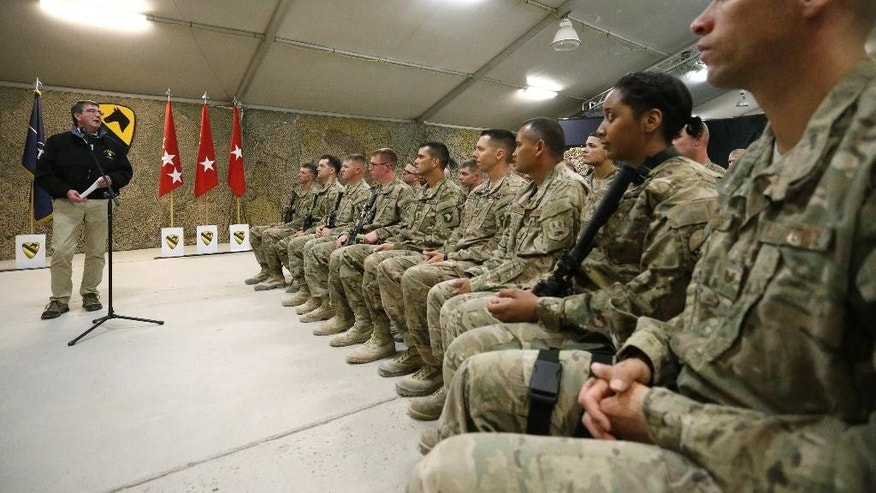 U.S. Defense Secretary Ash Carter, left, holds a question and answer session with soldiers at Kandahar Airfield in Afghanistan, Sunday, Feb. 22, 2015. Carter is making his first trip to visit troops and commanders in Afghanistan since his swearing-in this week. (AP Photo/Jonathan Ernst, Pool)