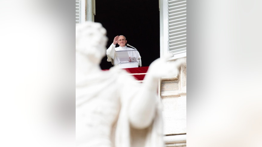 Feb. 22, 2015: Pope Francis waves to faithful from his studio window overlooking St. Peter's Square, during the Angelus noon prayer at the Vatican. (AP)