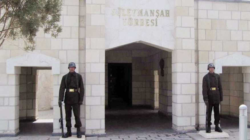 In this April 7, 2011 file photo, Turkish soldiers stand guard at the entrance of the memorial site of Suleyman Shah, grandfather of Osman I, founder of the Ottoman Empire, in Karakozak village, northeast of Aleppo, Syria.