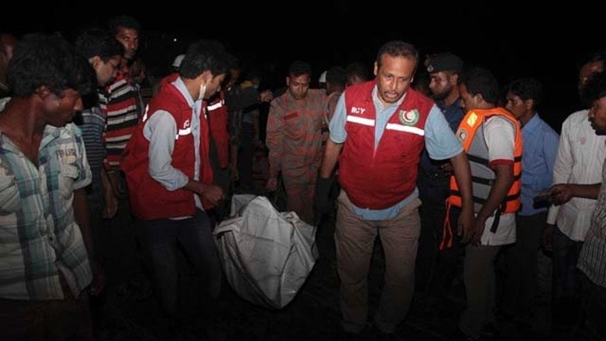 Feb. 22, 2014: Bangladeshi rescue workers carry the dead body of one of the victims after a river ferry carrying unto 140 passengers capsized Sunday after being hit by a cargo vessel,in Manikganj district, about 25 miles northwest of Dhaka. (AP Photo/ A.M. Ahad)