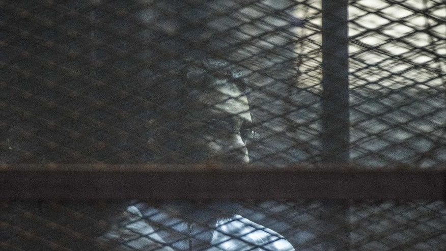 Feb. 23, 2015 - Egyptian activist Alaa Abd el-Fattah during a verdict hearing for 21 people over an unauthorized street protest in 2013, in a Cairo, Egypt courtroom. The court sentenced el-Fattah to 5years in prison.