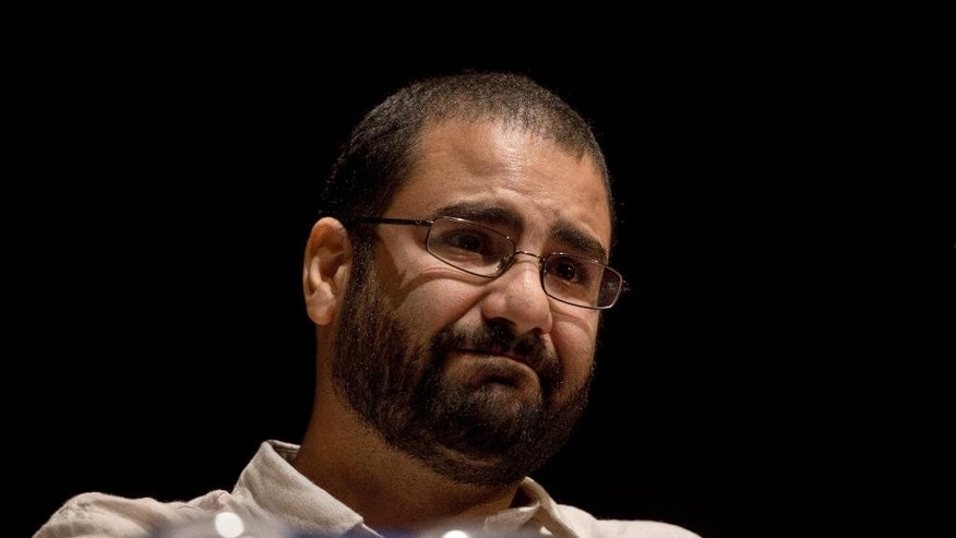 In this Monday, Sept. 22, 2014 photo, Egypt's most prominent activist Alaa Abdel-Fattah takes a moment as he speaks about his late father Ahmed Seif, one of Egypt's most respected human rights lawyers, during a conference held at the American University in Cairo, Egypt, near Tahrir Square. A court in Egypt has sentenced Abdel-Fattah, an icon of its 2011 revolt to five years in prison after a retrial on Monday, Feb. 23, 2015. (AP Photo/Nariman El-Mofty)