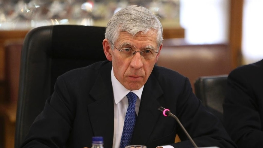 FILE - This is a Wednesday, Jan. 8, 2014 file photo of  Britain's former Foreign Secretary Jack Straw as he  listens to Alaeddin Boroujerdi, head of the Iranian parliament's foreign policy and national security committee, during their meeting at the Iranian parliament in Tehran, Iran.  Two former senior British government ministers Jack Straw and Malcolm Rifkind denied  Monday Feb 23, 2015, any wrongdoing after being caught in a hidden-camera sting appearing to offer access to politicians and diplomats in return for cash. (AP Photo/Vahid Salemi, File)