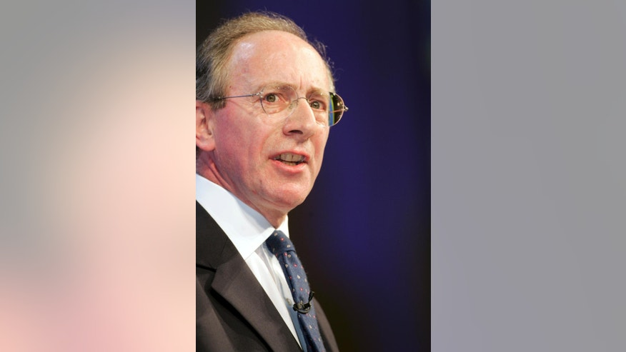 FILE - This is a Monday Oct. 3, 2005   file photo of British Conservative Party MP Malcolm Rifkind, a contender to be the new leader of the party, as he  speaks during the 2005 Conservative Party Conference in Blackpool, England..  Two former senior British government ministers Malcolm Rifkind and Jack Straw denied  Monday Feb. 23, 2015, any wrongdoing after being caught in a hidden-camera sting appearing to offer access to politicians and diplomats in return for cash. (AP Photo/Paul Ellis, File)