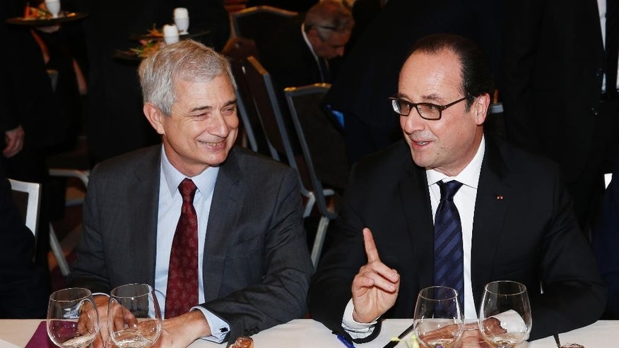 French President Francois Hollande, right, attends the 30th annual dinner held by the French Jewish Institutions Representative Council (Conseil Representatif des Institutions juives de France, CRIF) next to French Parliament President Claude Bartolone, left, in Paris, France, Monday, Feb. 23, 2015. French president Francois Hollande addresses the Jewish council's annual dinner to express France's solidarity toward the Jewish community as anti- semitism acts are on the rise in the country. (AP Photo/Etienne Laurent, pool)