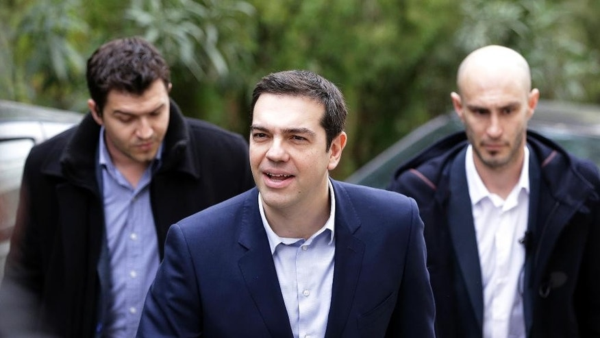 Greece's Prime Minister Alexis Tsipras arrives for a meeting with Greek composer Mikis Theodorakis in Athens, Tuesday, Feb. 24, 2015. Caught between its own defiant campaign pledges and pressure from creditors, Greece's left-wing government will deliver a list of reforms Tuesday to debt inspectors for final approval of extended rescue loans, officials said. (AP Photo/Thanassis Stavrakis)
