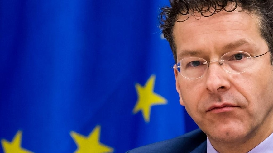 """Dutch Finance Minister and the head of the eurogroup Jeroen Dijsselbloem attens a meeting of the Committee on Economic and Monetary Affairs at the European Parliament in Brussels on Tuesday, Feb. 24, 2015. An official at the European Union's executive branch said Tuesday that the list of Greek reform measures for final approval of the extended rescue loans """"is sufficiently comprehensive to be a valid starting point."""" Dijsselbloem said that he received the list last night and that """"it is being assessed at the moment by the institutions."""" (AP Photo/Geert Vanden Wijngaert)"""