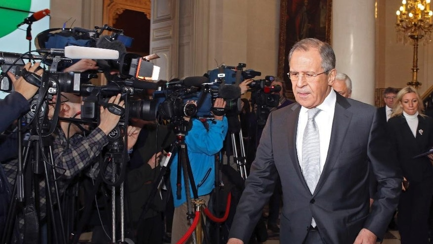 Russian Foreign Minister Sergei Lavrov leaves the French Foreign Affairs Ministry following a meeting in Paris, Tuesday, Feb. 24, 2015. Talks about a fragile peace deal for Ukraine are underway in Paris between the foreign ministers of Russia, Ukraine, Germany and France. (AP Photo/Remy de la Mauviniere/Pool)