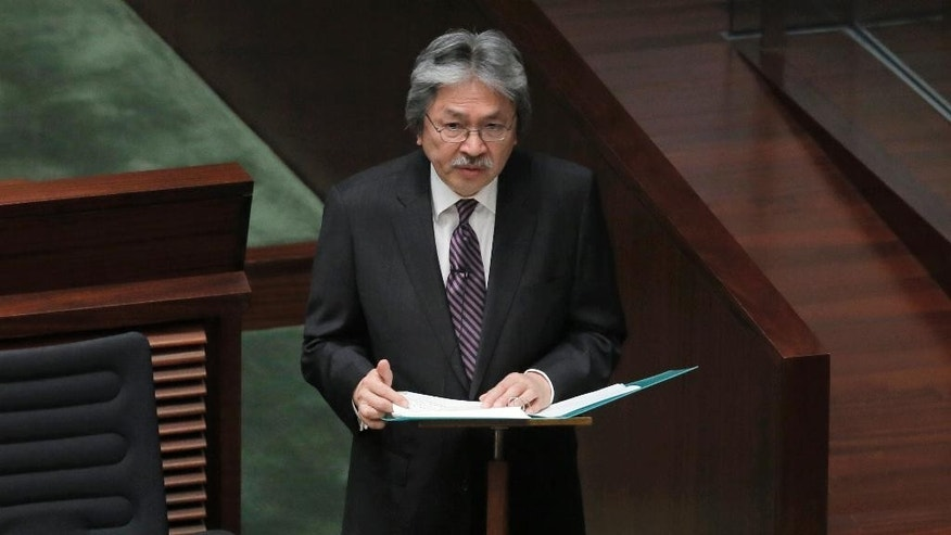Hong Kong's Financial Secretary John Tsang delivers his annual budget speech at the Legislative Counci in Hong Kong Wednesday, Feb. 25, 2015. Tsang unveiled $37 million in measures aimed at giving relief to some business owners and restoring confidence in the Asian financial hub following pro-democracy protests last year that choked traffic for 11 weeks. (AP Photo/Vincent Yu)