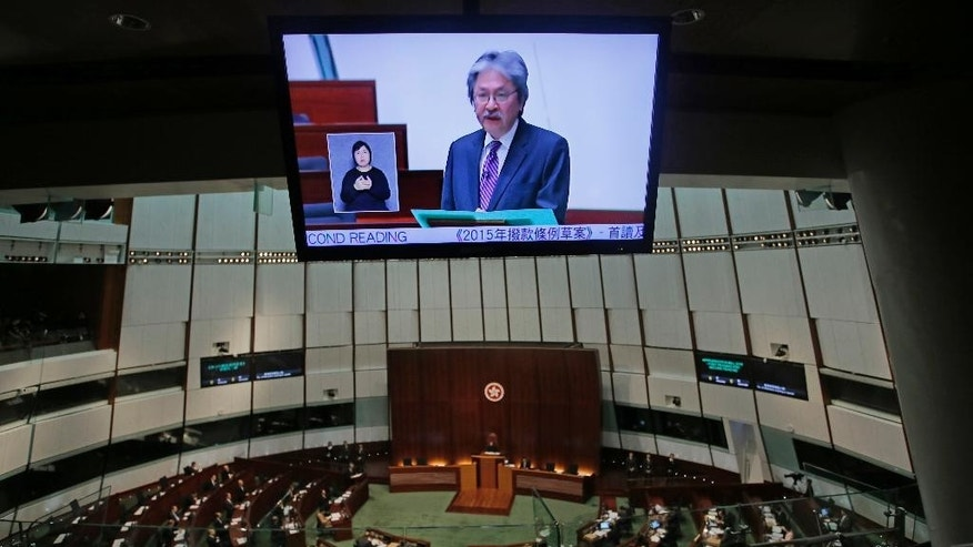 Hong Kong's Financial Secretary John Tsang is seen on a TV screen as he delivers his annual budget speech at the Legislative Counci in Hong Kong Wednesday, Feb. 25, 2015. Tsang unveiled $37 million in measures aimed at giving relief to some business owners and restoring confidence in the Asian financial hub following pro-democracy protests last year that choked traffic for 11 weeks. (AP Photo/Vincent Yu)
