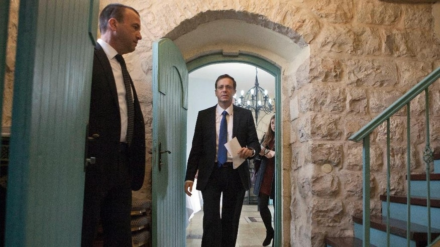 """Israel's Labor Party leader Isaac Herzog arrives to a press conference in Jerusalem, Tuesday, Feb. 24, 2015. Herzog said the upcoming speech by Prime Minister Benjamin Netanyahu at the U.S. Congress on Iran is """"spin"""" ahead of March elections. Herzog is competing against Netanyahu in the March 17 election. (AP Photo/Dan Balilty)"""