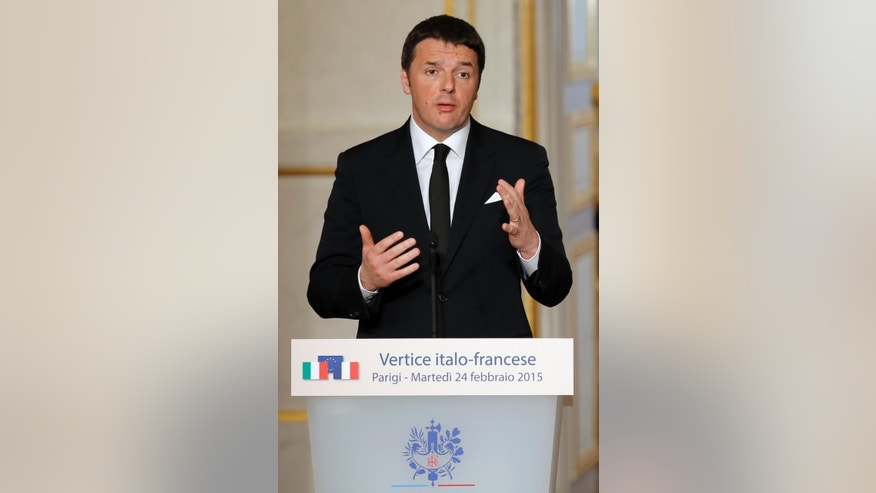Italian Premier Matteo Renzi delivers his speech during a joint press conference with French President Francois Hollande ending the Franco-Italian summit at the Elysee Palace in Paris, France, Tuesday, Feb. 24, 2015. (AP Photo/Francois Mori, pool)
