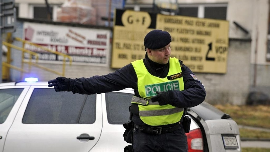 A police officer controls traffic near a restaurant where a gunman opened fire in Uhersky Brod, east of the Czech Republic, Tuesday, Feb. 24, 2015. (AP Photo/CKT, Dalibor Gluck) ** SLOVAKIA OUT **