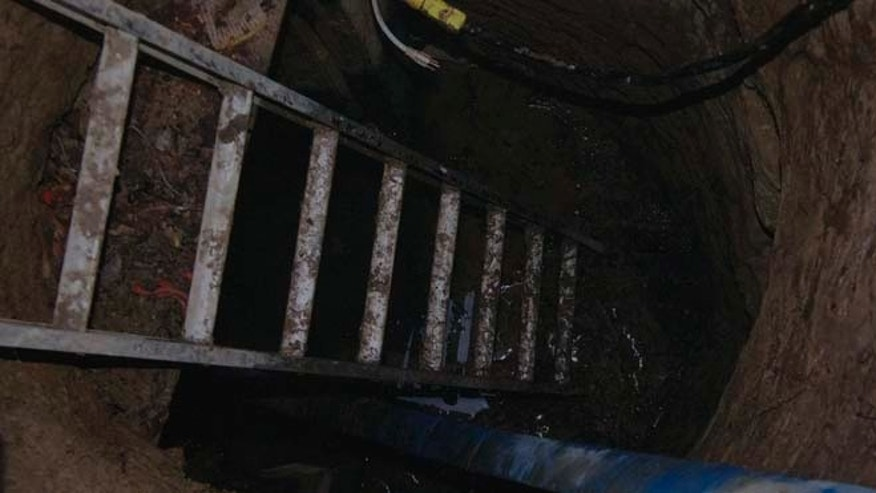 Feb. 24, 2015: A copy of a Toronto Police photo of  a tunnel found near York University in Toronto is shown during a press conference in Toronto. Police are asking for the public's help in trying to determine who built the mysterious underground tunnel.