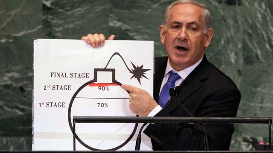 File - In this Sept. 27, 2012, file photo, Prime Minister Benjamin Netanyahu of Israel shows an illustration as he describes his concerns over Iran's nuclear ambitions during his address to the 67th session of the United Nations General Assembly at U.N. headquarters. (AP Photo/Richard Drew, File)