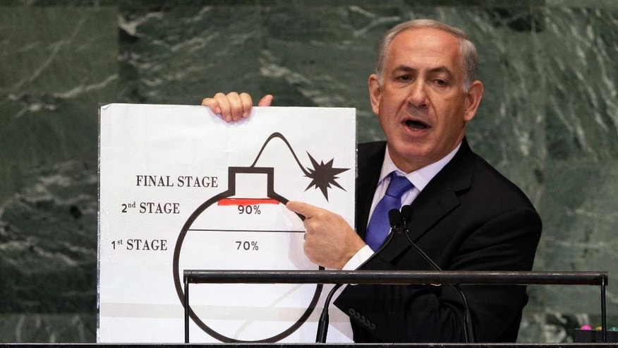 File - In this Sept. 27, 2012, file photo, Prime Minister Benjamin Netanyahu of Israel shows an illustration as he describes his concerns over Iran's nuclear ambitions during his address to the 67th session of the United Nations General Assembly at U.N. headquarters. Israel's Mossad spy agency in October 2012 had a less alarmist view of Iran's nuclear program than an assessment delivered by Netanyahu at the United Nations just a few weeks earlier, according to a purported secret cable published Monday, Feb. 23, 2015, by two media outlets. (AP Photo/Richard Drew, File)
