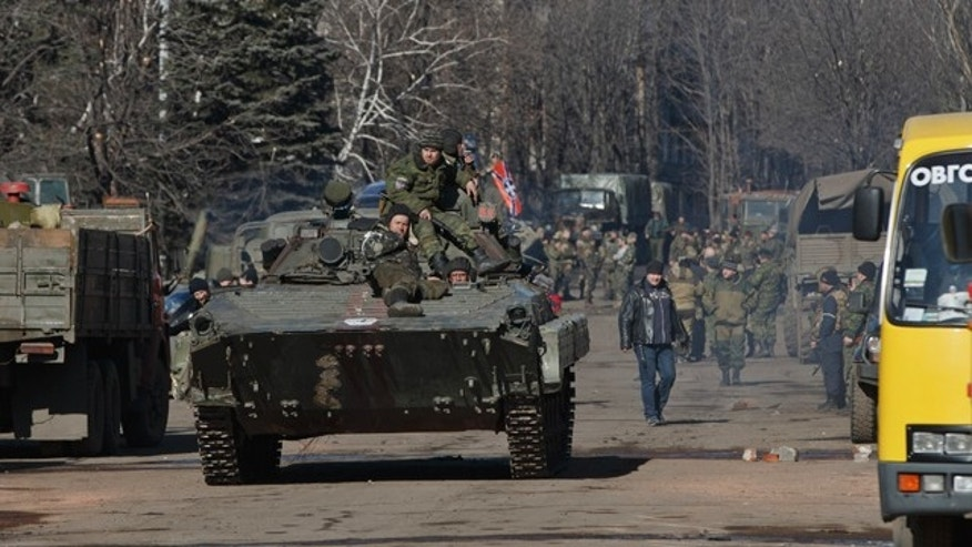 Feb. 23, 2015: Russia-backed rebels ride on an armored vehicle in the center of Debaltseve, Ukraine. (AP Photo/Vadim Ghirda)