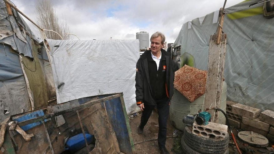 Jan Egeland, the secretary general of the Norwegian Refugee Council and former U.N. humanitarian chief, walks between tents at a Syrian refugee camp in the town of Marej in the Bekaa valley, east Lebanon, Wednesday, Feb. 25, 2015. Egeland, the head of the prominent humanitarian relief organization, told the Associated Press in an interview that UN Security Council resolutions seeking to boost humanitarian access to reach millions of Syrians in desperate need of help have had no effect. (AP Photo/Hussein Malla)