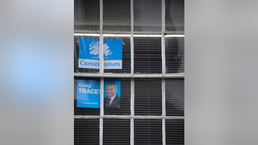 In this photo taken on Friday, Feb. 20, 2015, Conservative posters seen in a window at the Conservative office for North Warwickshire constituency, Coleshill, England, ahead of May's General Election. British voters go to the polls May 7 in the most unpredictable election in decades. All parties are trying to woo voters in the North Warwickshire constituency, one of the country''s closest races. (AP Photo/Rui Vieira)
