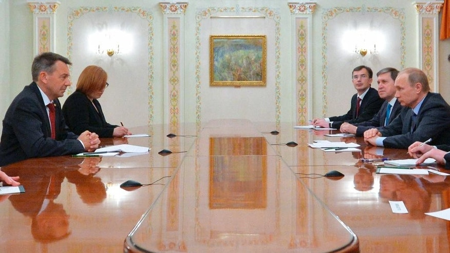 Russian President Vladimir Putin, right, meets with Peter Maurer, President of the International Committee of the Red Cross (ICRC), in the Novo-Ogaryovo residence outside Moscow, Russia, Tuesday, Feb. 24, 2015. (AP Photo/RIA-Novosti, Alexei Druzhinin, Presidential Press Service)