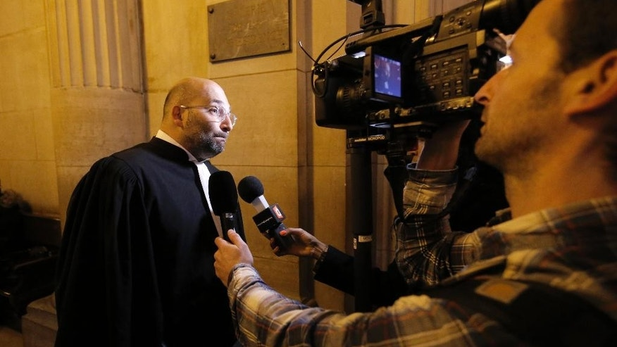 French lawyer Slim Ben Achour talks to the media at the Paris appeals court, in Paris, France, Wednesday, Feb. 25, 2015. A Paris appeals court is rehearing a racial profiling case brought by 13 men — all black or of North African origin — who claim they've been victims of numerous, unjustified police identity checks because of their ethnicity. (AP Photo/Francois Mori)
